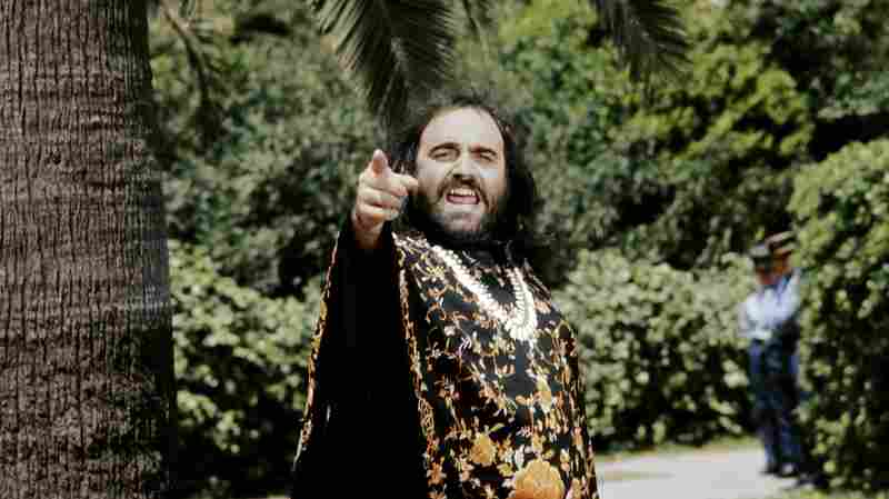 International pop star Demis Roussos hams it up for the camera at the Cannes Film Festival in May 1975. Roussos died in Athens Sunday at age 68.