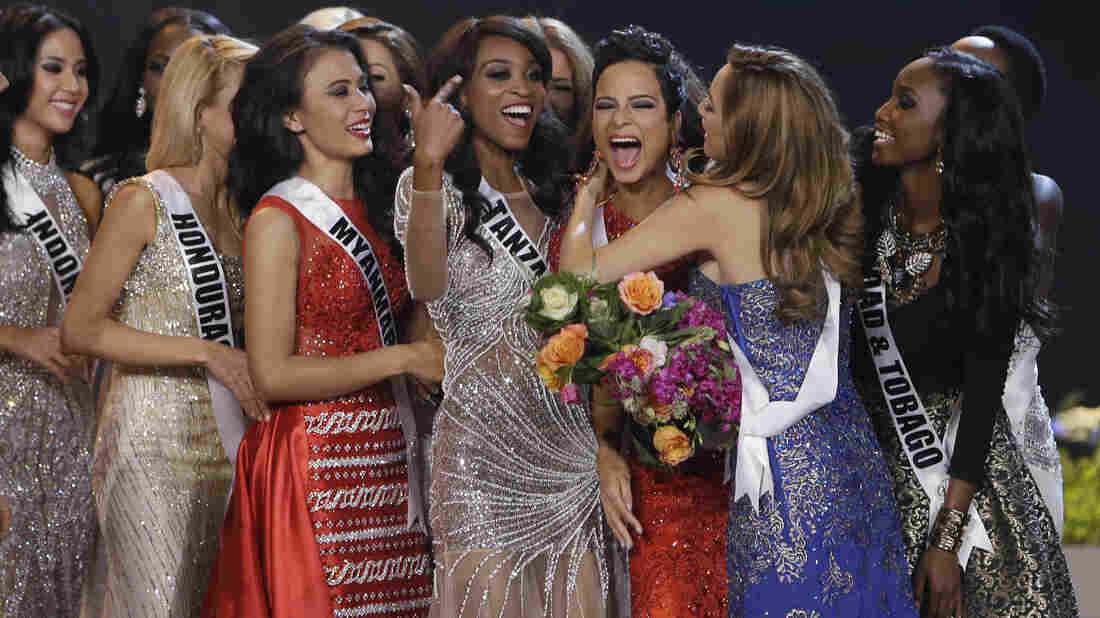 Miss Universe contestants congratulate fifth-place-finisher, Kaci Fennell of Jamaica. Many pageant watchers on social media argued that Fennell should have won.