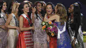 Miss Universe contestants congratulate fifth-place-finisher, Kaci Fennell, of Jamaica. Many pageant watchers on social media argued that Fennell should have won.