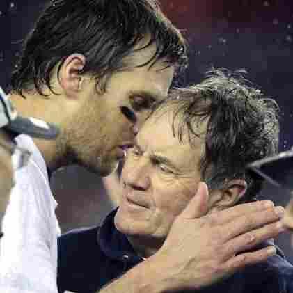 New England Patriots quarterback Tom Brady, left, speaks with coach Bill Belichick, after the AFC Championship game Sunday, Jan. 18, 2015, in Foxborough, Mass.