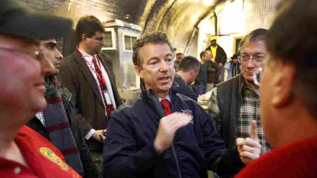 Sen. Rand Paul, R-Ky., center, meets with members of the Londonderry Fish and Game Club in Litchfield, N.H., on Jan. 14. Paul was one of three GOP presidential hopefuls who attended Sunday's semiannual gathering of David and Charles Koch's donor network in California.