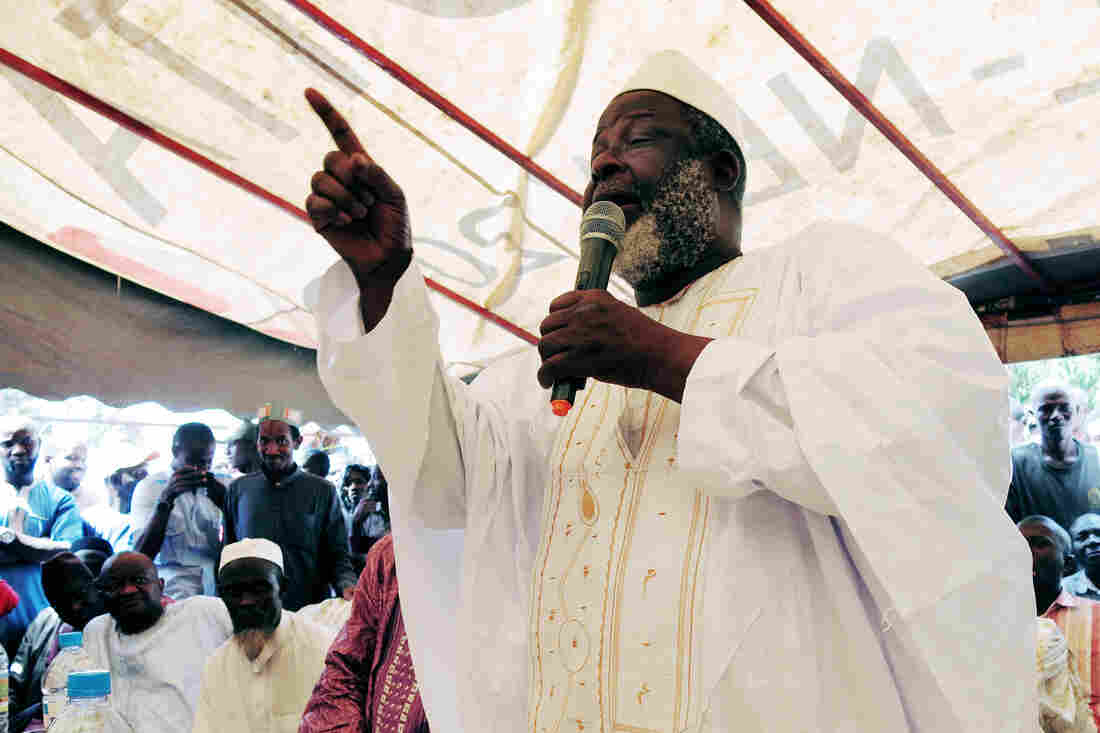"Guinea's Grand Imam, El Hadj Mamadou Saliou Camara, tells his fellow clerics: ""If there is any doubt at all, then no one must touch the body."""