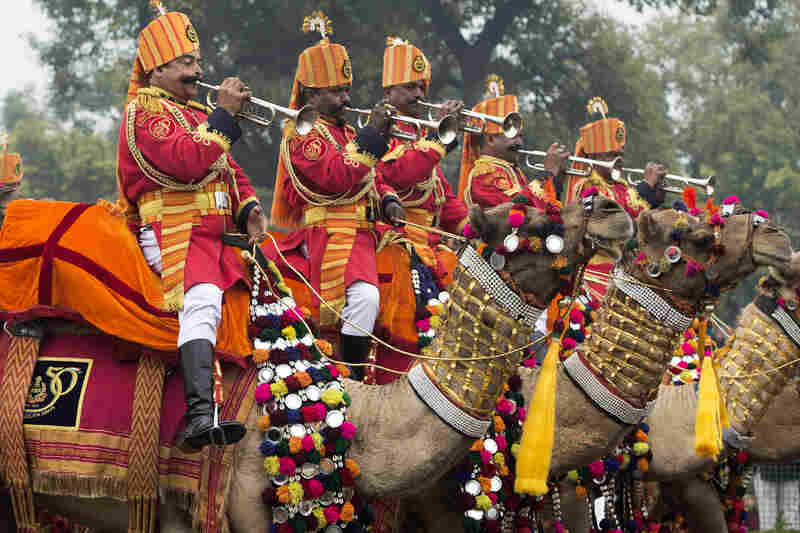 Trumpeters from the Indian Border Security Force's Camel Mounted Band play during the nation's Republic Day parade in New Delhi on Monday. Rain failed to dampen spirits as President Obama became the first U.S. president to attend the spectacular military and cultural display.