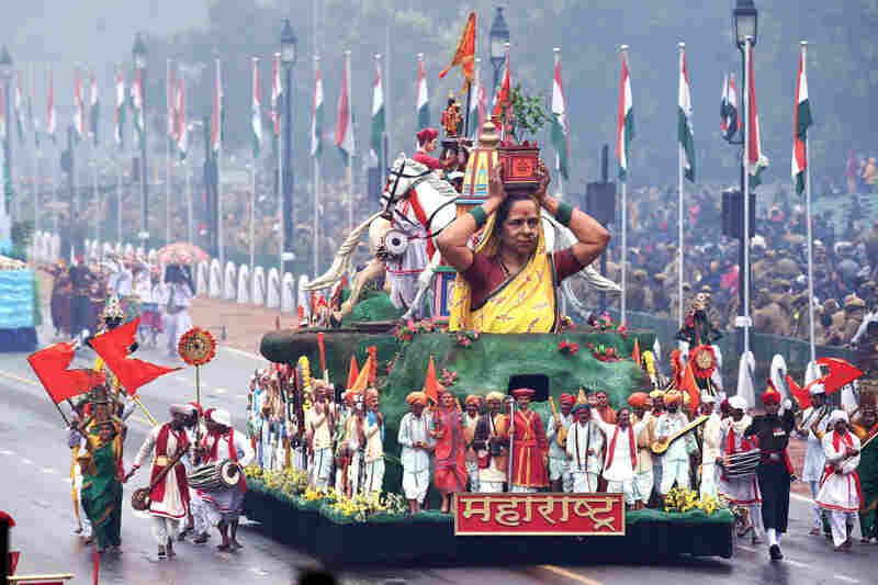 Indian performers walk alongside a float representing the state of Mahrashtra during the parade.