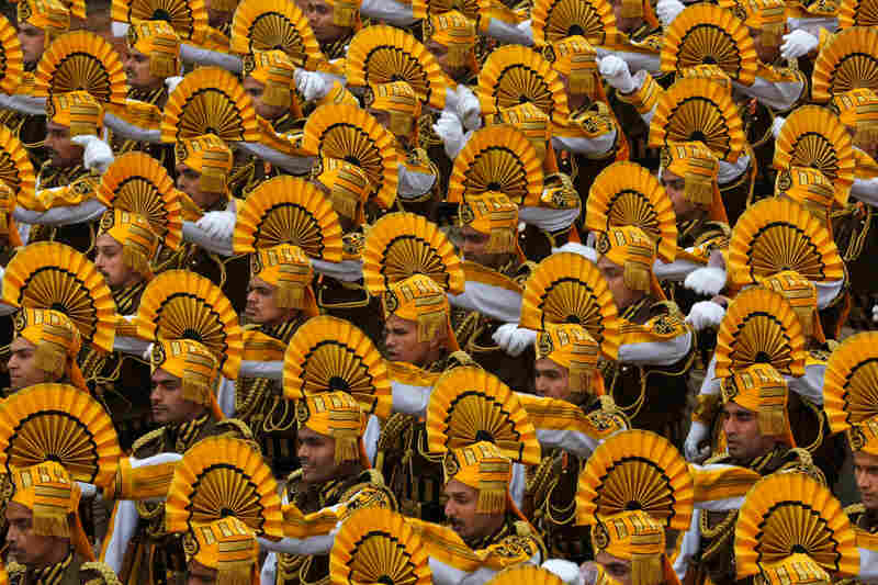 Indian paramilitary soldiers march during the parade, marking the anniversary of India's democratic constitution taking force in 1950. Beyond the show of military power, the parade includes ornate floats highlighting India's cultural diversity.