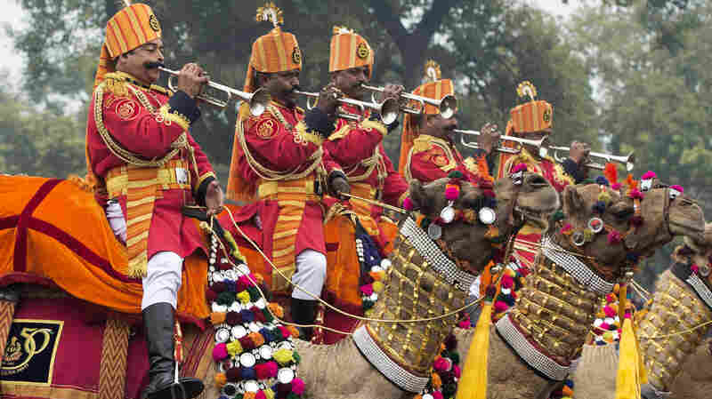Trumpeters from the Indian Border Security Force's Camel Mounted Band play their instruments while riding their camels during the nation's Republic Day parade in New Delhi on Monday. Rain failed to dampen spirits as President Obama became the first U.S. president to attend the spectacular military and cultural display.