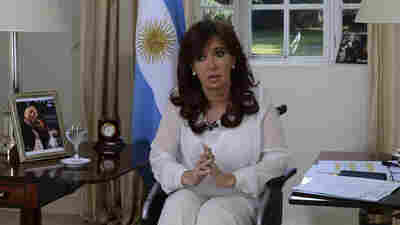 Argentina's President Cristina Fernandez, sitting in a wheelchair, announces her plan to replace her country's intelligence service with a new agency.