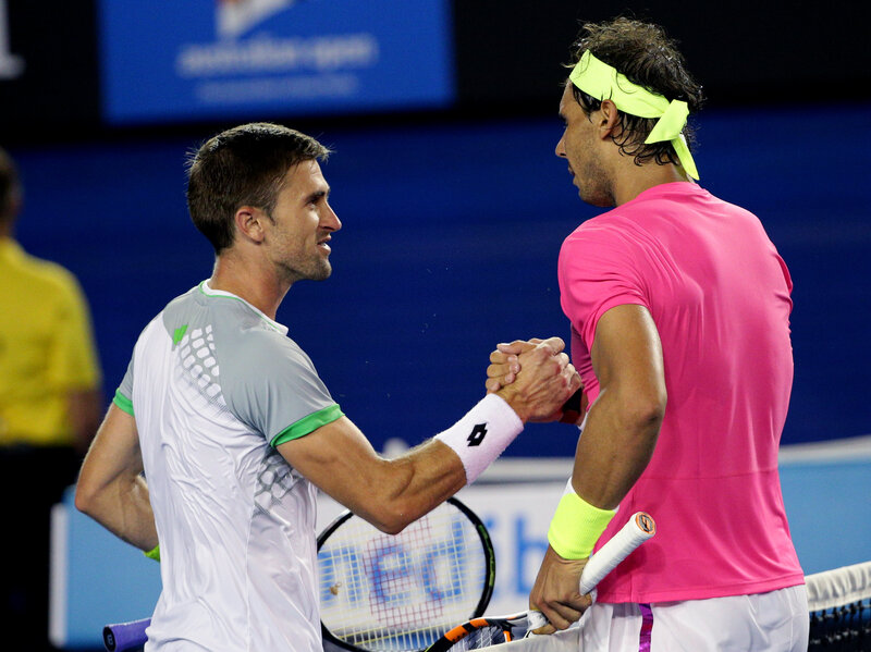 Rafael Nadal (right) shakes hands with Tim Smyczek after winning a match at the Australian Open on Jan. 21.