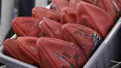 Official game balls for this year's Super Bowl sit in a bin before being laced and inflated at the Wilson Sporting Goods Co. in Ada, Ohio.