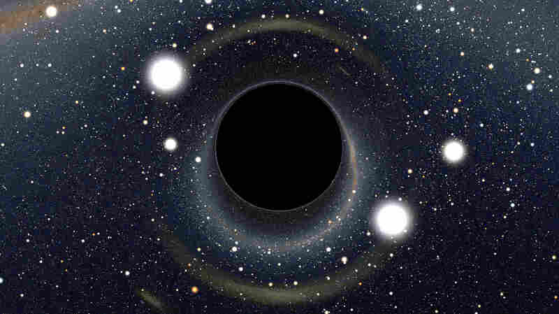 Some physicists are pushing back against ideas like String Theory and the Multiverse. Here, we see a computer-generated image of a black hole, which might, ultimately, be explained by ideas like String Theory.