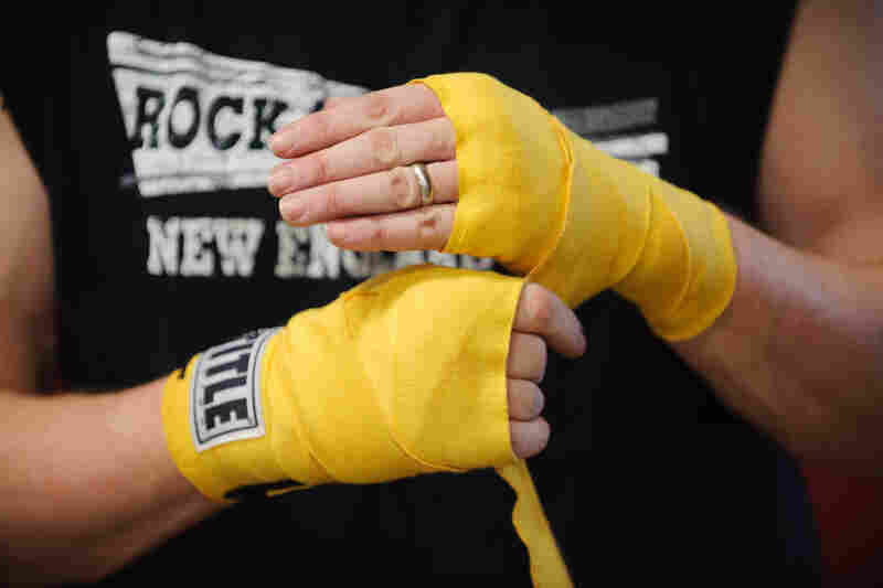 Quaglia unwraps his hands after a punching exercise.