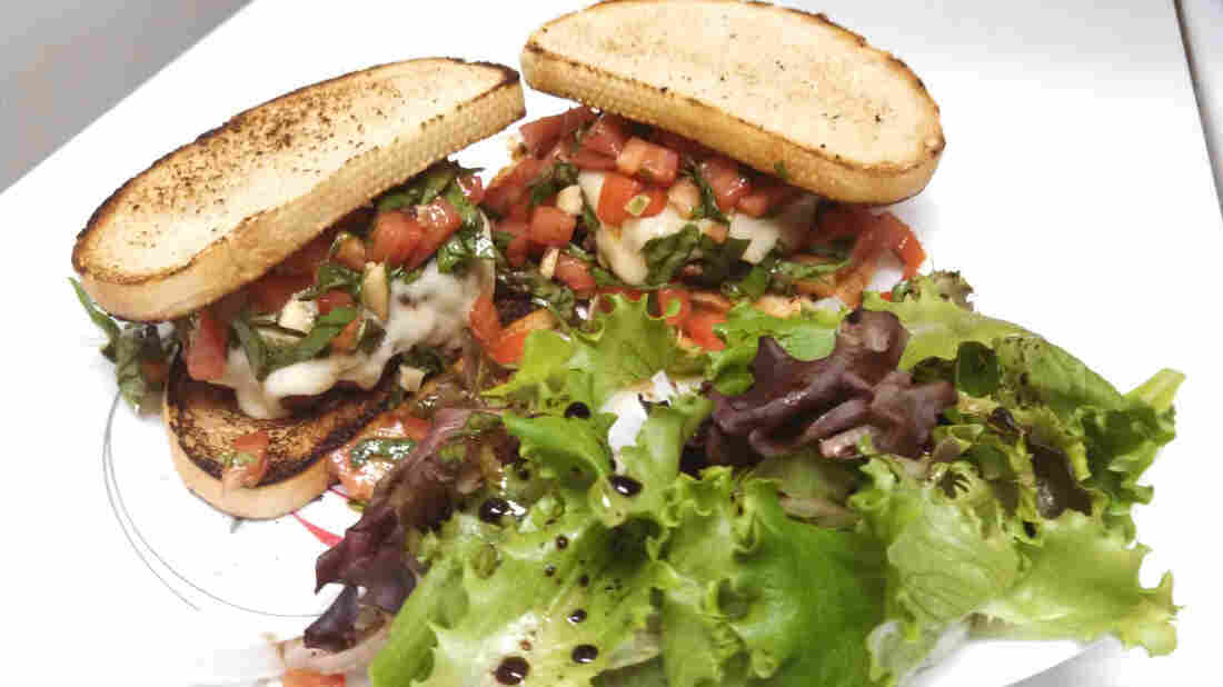 """Bowden says his go-to burger is the Bruschetta-bout it Burger, one of his first burger attempts. """"I remember biting into it and being like, 'Yes, I can make burgers,' """" he says."""