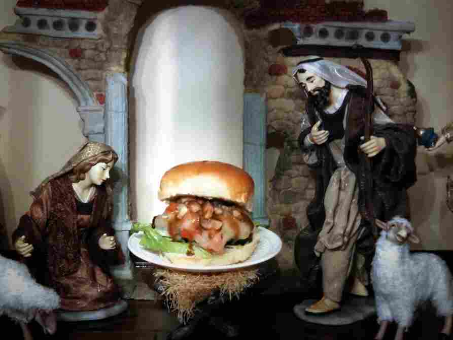 """The """"Cheeses Is Born Burger,"""" displayed on Bowden's mother's Nativity scene. """"My mom was not too thrilled with me taking baby Jesus out of the scene and putting a burger in its place,"""" says Bowden."""