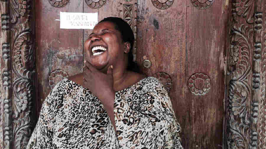 Zuhura Khamisi laughs outside of The Recovery Community Zanzibar.