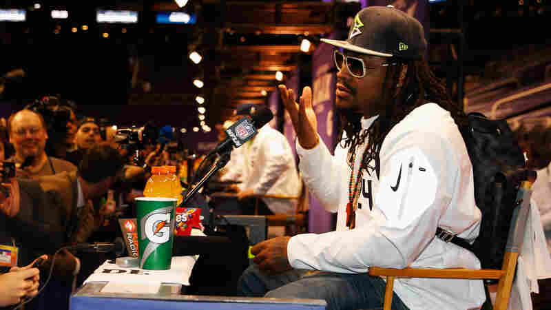 "Addressing journalists at the Super Bowl media day, Marshawn Lynch had only one message: ""I'm just here so I won't get fined."""