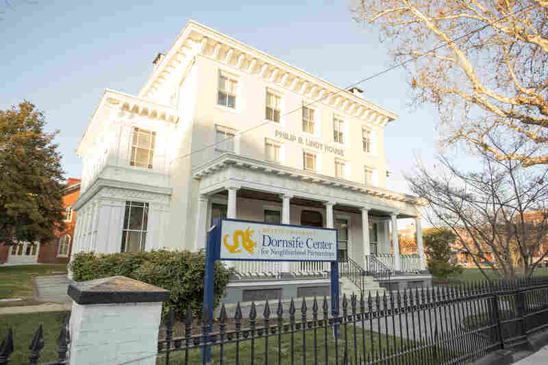 A newly renovated white mansion houses most of the offices for Drexel University's Dornslife Center for Neighborhood Partnerships.