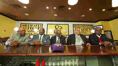 Five members of the Friendship Nine (from left to right): Willie Thomas Massey, Willie E. McCleod, James F. Wells, Clarence Graham and David Williamson, Jr. sit at the lunch counter at Five & Dine diner in Rock Hill, S.C. on Dec. 17, 2014.