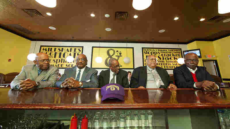 Five members of the Friendship Nine — Willie Thomas Massey (from left), Willie McCleod, James Wells, Clarence Graham and David Williamson Jr. — sit at the counter of the Five & Dine restaurant in Rock Hill, S.C., on Dec. 17. A judge in South Carolina has thrown out the convictions of the nine black men who integrated a whites-only lunch counter in 1961.