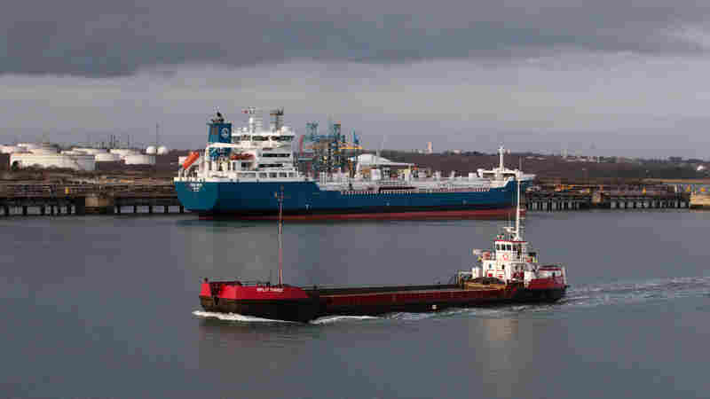 Tankers are berthed beside the Fawley oil refinery on Jan. 7, in Southampton, England. With low oil prices, some traders are buying oil and storing it in tankers, hoping the price will rise soon so they can sell it at a profit.