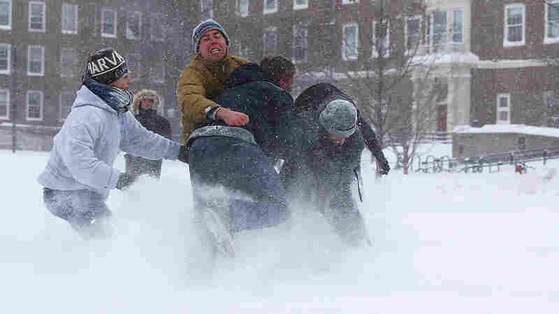 Students play football at the Quad, on the campus of Harvard University on Tuesday in Cambridge, Massachusetts.