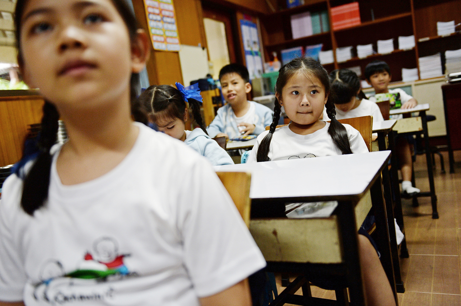Girl students in Bangkok tend to do better than boys. That's the finding of a new study. (Christophe Archambault/AFP/Getty Images)