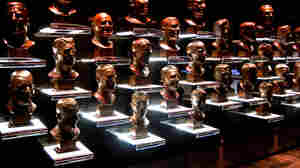 There are more than 160 living Hall of Fame football players. The famous busts of the inductees line the walls in the Pro Football Hall of Fame in Canton, Ohio.