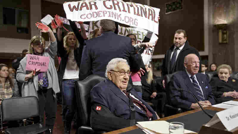 Protesters interrupt the start of a Senate Armed Services hearing on Capitol Hill Thursday, as former Secretary of State Henry Kissinger prepares to testify.