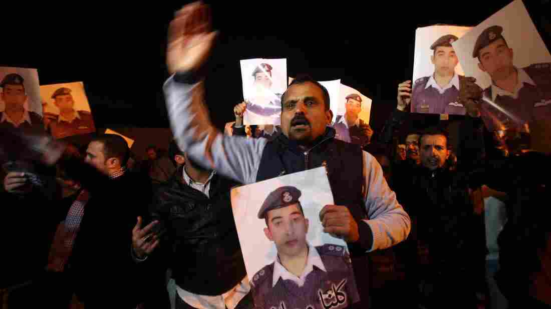 Relatives of Jordanian pilot Lt. Muath al-Kaseasbeh, who was captured by ISIS militants in Syria, protest Tuesday in front of the royal palace in Amman, Jordan. Jordan has suggested it might be willing to hold a prisoner exchange for his release.