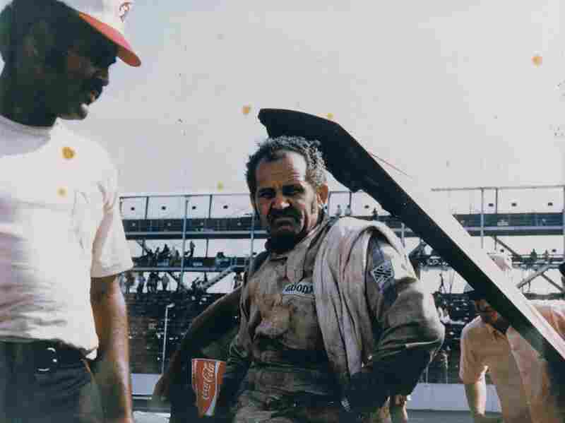 Wendell Scott (right) and his son Frank in Darlington, S.C., in 1970. Wendell Scott becomes the first African-American driver inducted into the NASCAR Hall of Fame on Friday.