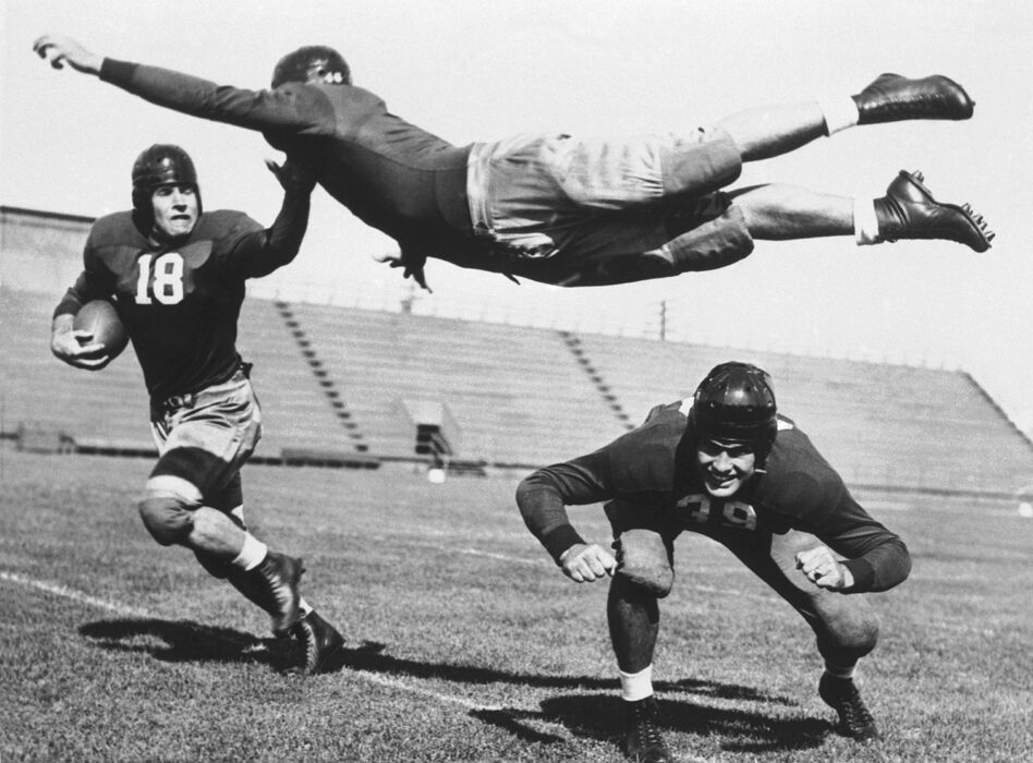 Football rules, uniforms, helmets and protective gear have changed a lot over the years. (Keystone-France/Gamma-Keystone via Getty Images)