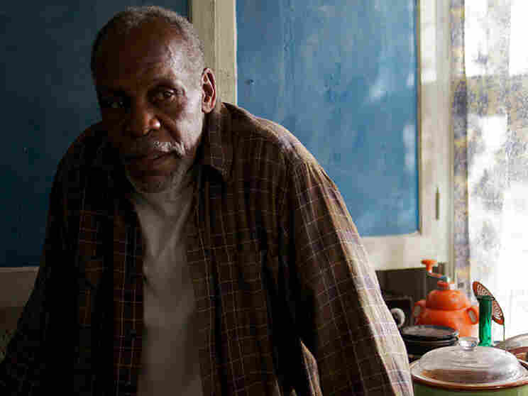 Danny Glover plays Mr. Walker, the head of the black family held hostage by a white supremacist, in Supremacy.