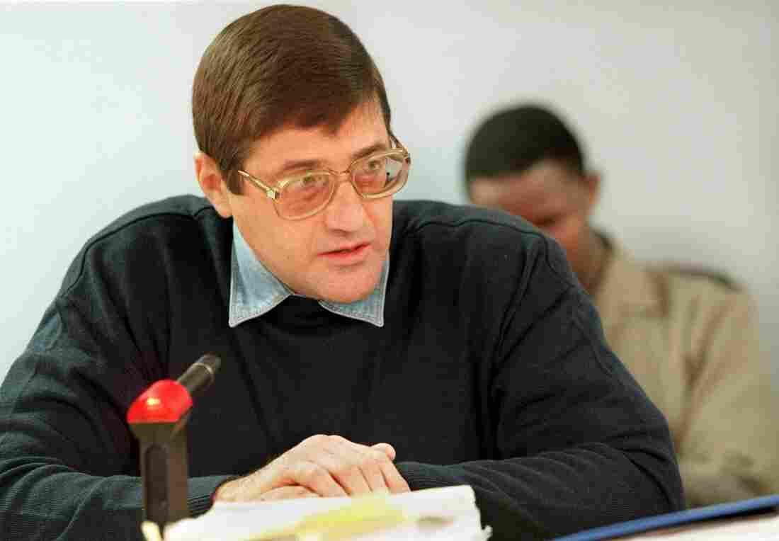 Eugene De Kock a former Vlakplaas commander speaks to the judge at a Truth and Reconciliation Commission in 1999. De Kock, the apartheid regime's top assassin, asked the commission for amnesty for over 100 incidents of torture, murder and fraud.