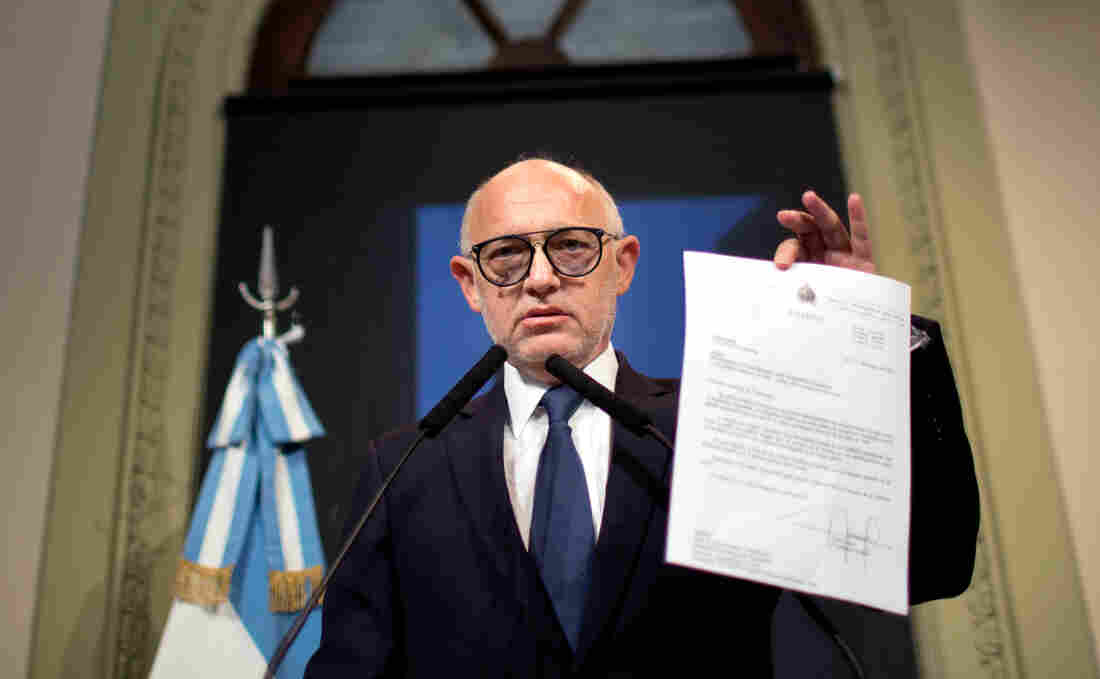 Argentina's Foreign Minister Hector Timerman on Jan. 15 shows a letter he said was sent in 2013 to Interpol informing it of an agreement reached with Iran's government to investigate the 1994 bombing of the Argentine-Israeli Mutual Association that killed 85 people. Timerman says he met with Iran in an attempt to solve the case and denies accusations he was part of a cover-up.