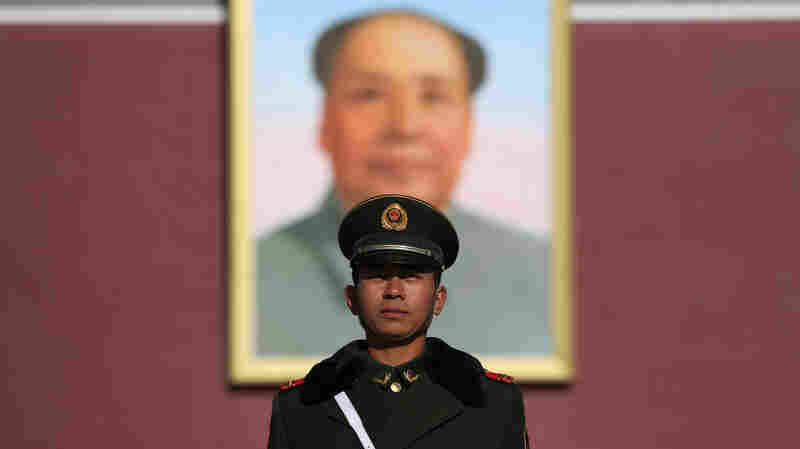 A Chinese paramilitary police officer stands in front a portrait of late Chinese leader Mao Zedong outside the Forbidden City in Beijing, in November.