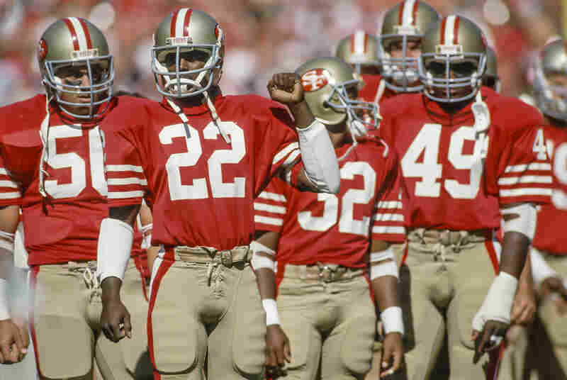 Dwight Hicks (#22) psychs up before a 1985 game, flanked by San Francisco 49er teammates. Now a lead actor in X's and O's (A Football Love Story), Hicks played nine seasons in the NFL.