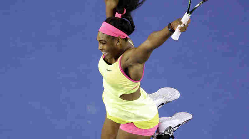 Serena Williams celebrates after defeating Maria Sharapova of Russia in their women's singles final at the Australian Open tennis championship in Melbourne, Australia on Saturday.