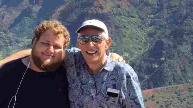 "Robert Schwimmer, 66, and his son Scott Schwimmer, 21, spoke with NPR about Robert's wish to hasten his death under certain circumstances. Here — as in the family photo above — they're in Kauai, Hawaii, on the family's ""last big trip"" after Robert received a 6-month prognosis in October."