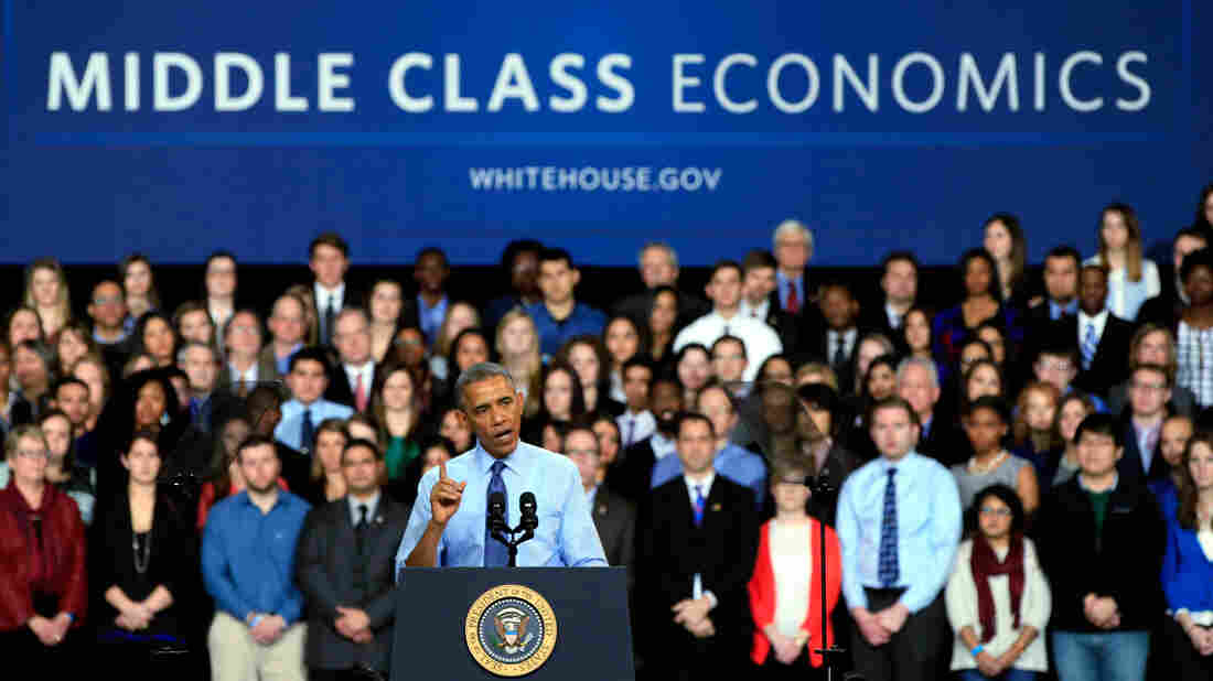 """President Obama, shown speaking at the University Of Kansas on Jan. 22, defends his budget as an exercise in """"middle-class economics."""" But forecasters at the nonpartisan Tax Policy Center say the 60 percent of Americans at the middle of the income ladder will more or less break even, while most benefits will go to low-income families."""