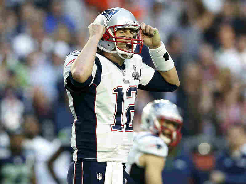 Tom Brady of the New England Patriots shouts at the line of scrimmage in the first quarter during Super Bowl XLIX at University of Phoenix Stadium in Glendale, Ariz.