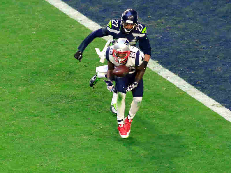 New England's Brandon LaFell catches an 11-yard touchdown against Tharold Simon of the Seattle Seahawks in the second quarter.