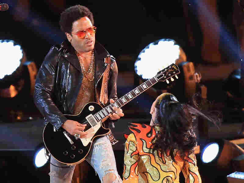 Musician Lenny Kravitz performs onstage with Katy Perry during the Pepsi Super Bowl XLIX Halftime Show.