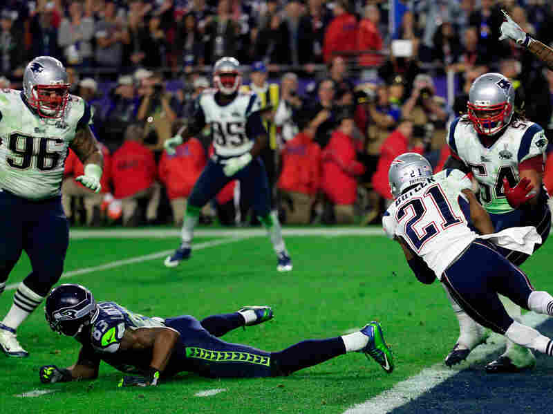 New England's Malcolm Butler (21) intercepts a Seattle pass intended for Ricardo Lockette (83) late in the fourth quarter, clinching the Patriots' 28-24 win.