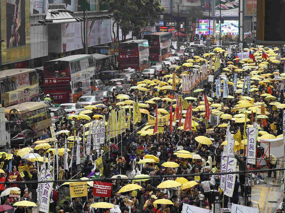 Thousands of pro-democracy activists on Sunday take part in a democracy march to Central, demanding universal suffrage in Hong Kong.