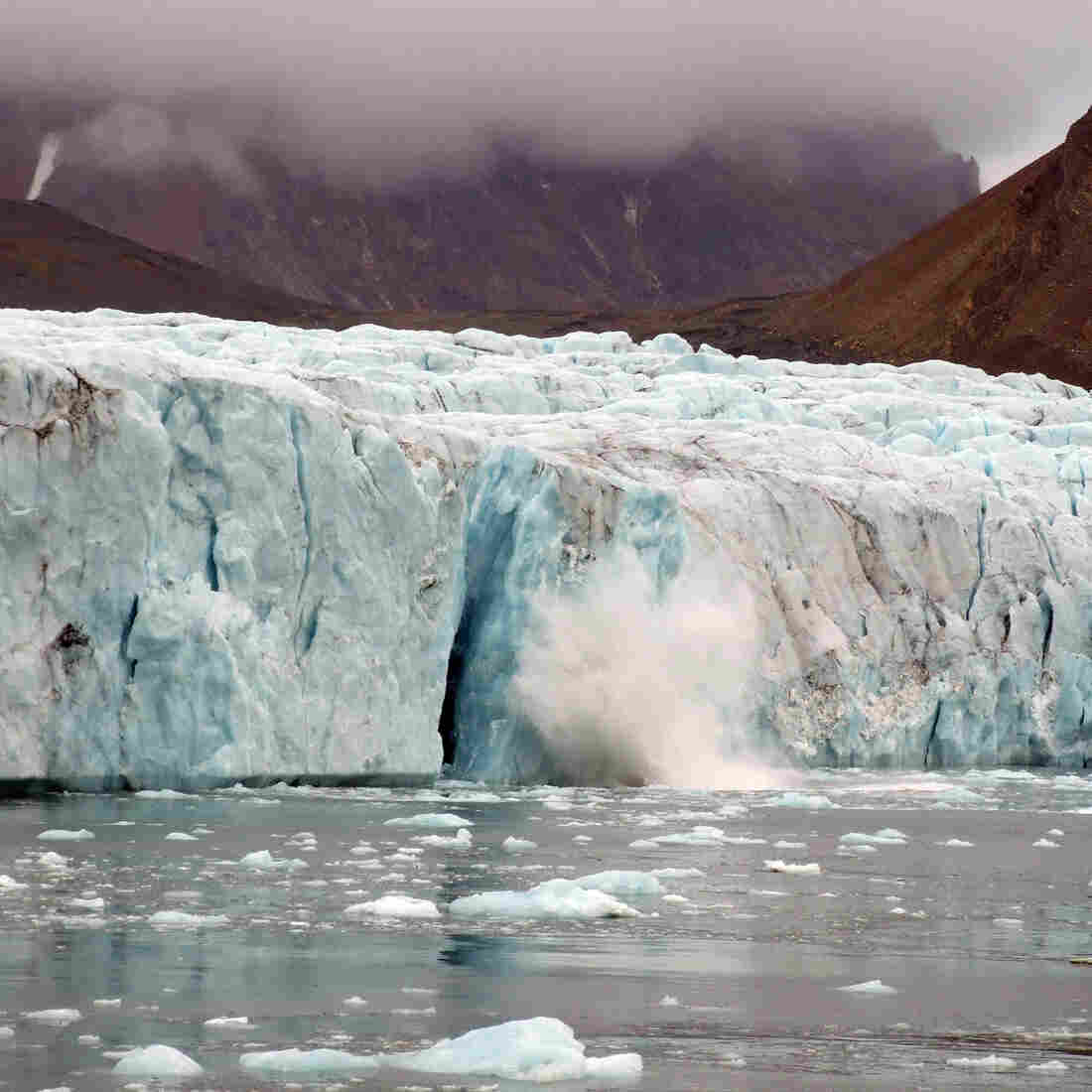 Giant chunks of ice break away from the Hans Glacier in Svalbard, Norway, in 2013.
