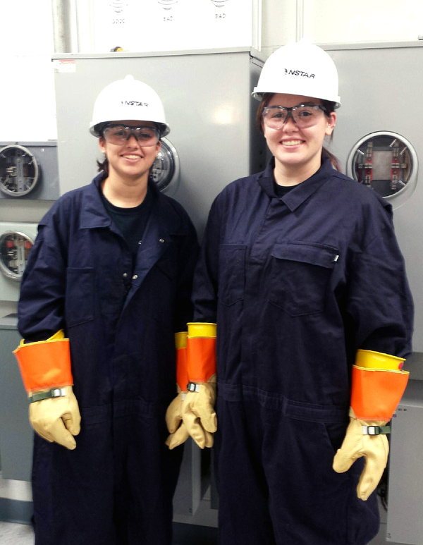 Haley Hughes (right) and Kristen Sabino stand in the meter training room at an NStar learning facility. The two are part of an apprenticeship program with the utility company, something economists say the U.S. needs more of in order to fill open trade jobs.