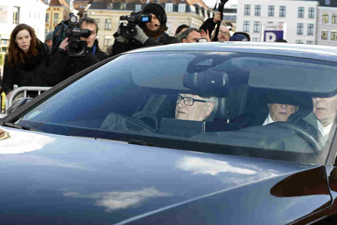 "Former IMF head Dominique Strauss-Kahn (partially seen in backseat of the car) arrives for the start of a trial in the ""Carlton Affair,"" in Lille, France, on Monday."