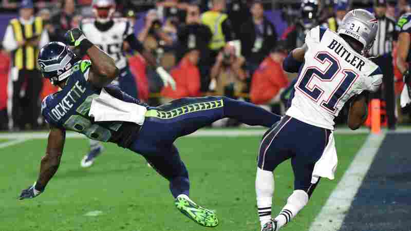 Malcolm Butler (right) of the New England Patriots intercepts a pass intended for Ricardo Lockette of the Seattle Seahawks late in the fourth quarter of Super Bowl XLIX on Sunday.
