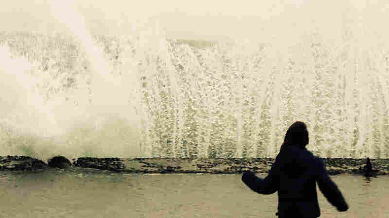In Istanbul, as the sky turned a dusty orange, people lined the Bosporus to see the wind-driven waves break onto the shore. One young girl seemed fascinated by the unexpected surf.