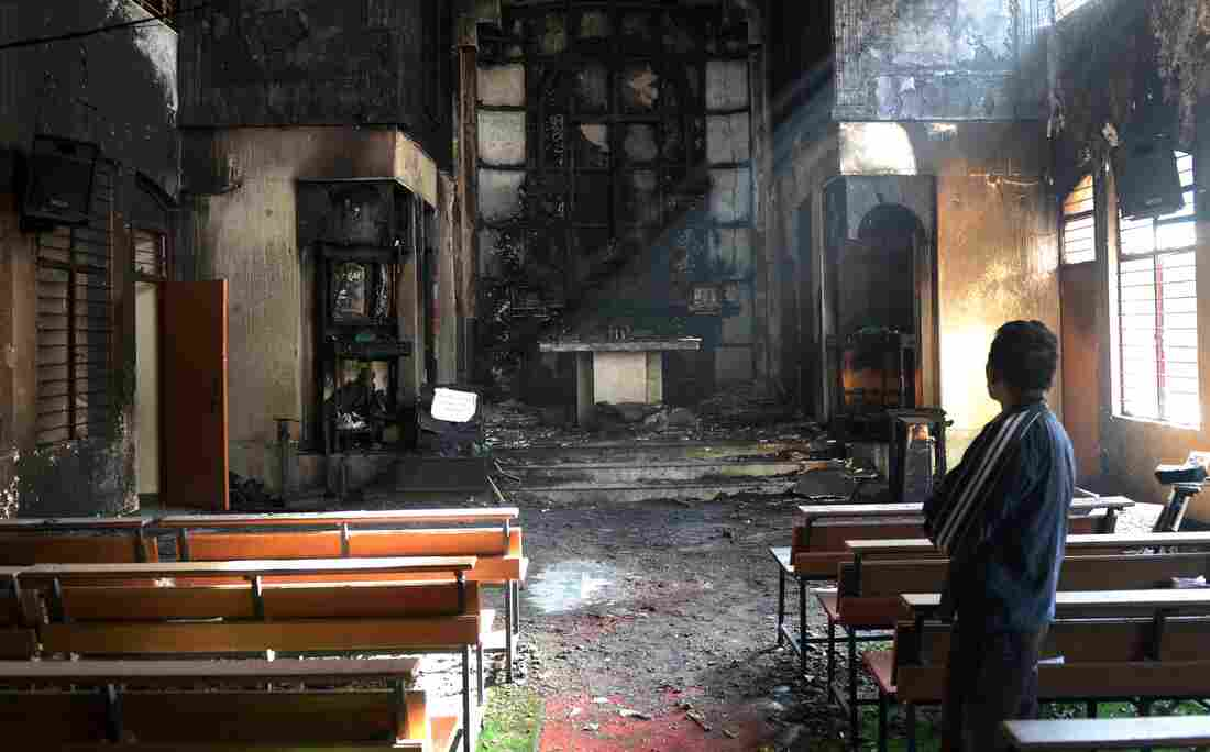 An Indian man on Dec. 2 surveys the damage following a fire a day earlier inside St. Sebastian's Church in New Delhi. This was the most serious of several incidents at churches since December. On a visit to India last week, President Obama urged Indians to respect religious freedom.