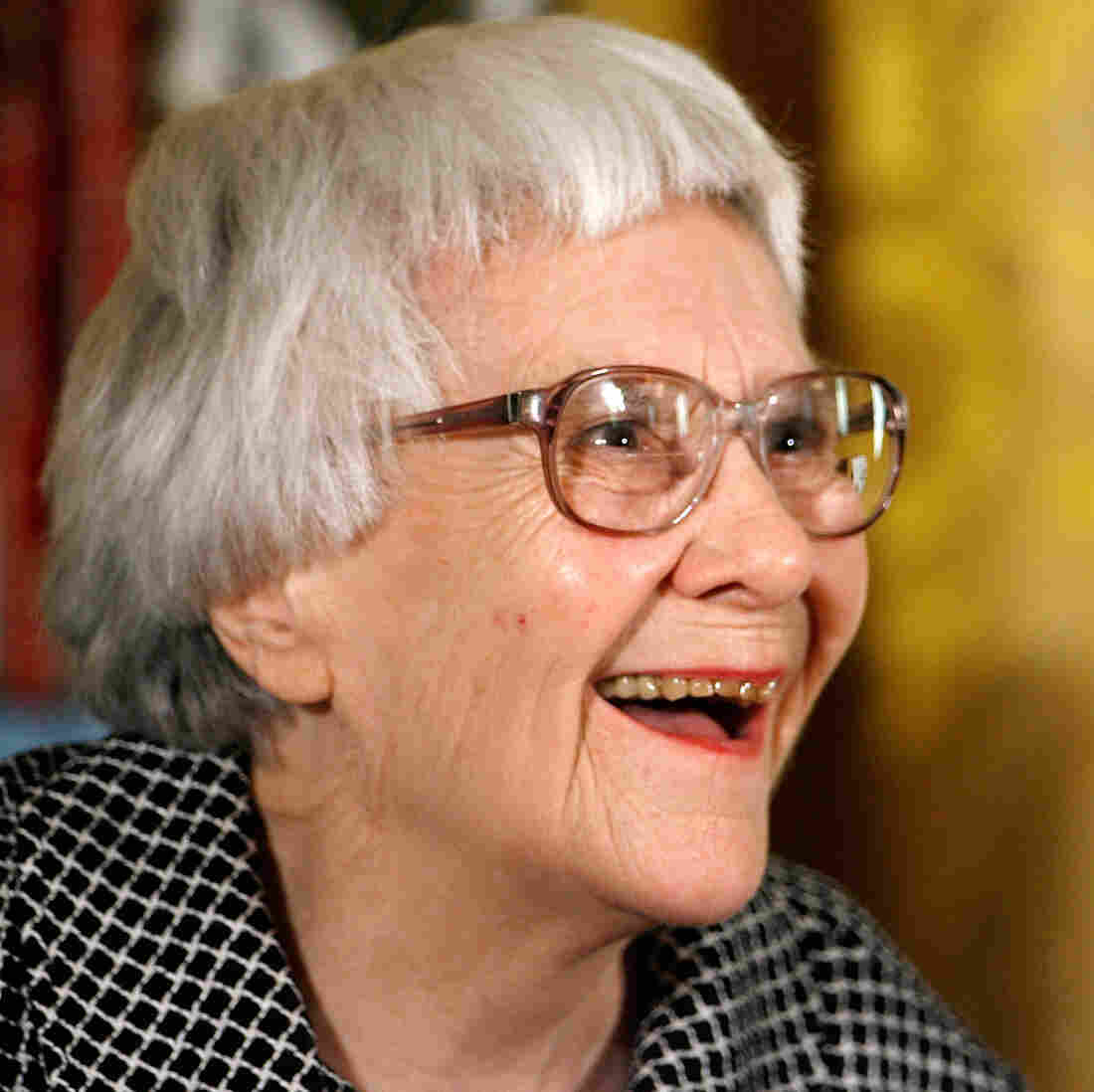 Harper Lee, seen here receiving the Presidential Medal of Freedom in 2007, actually wrote Go Set a Watchman first. But she set it aside when her editor suggested focusing on Scout's flashbacks instead — and she did, in what became To Kill a Mockingbird.
